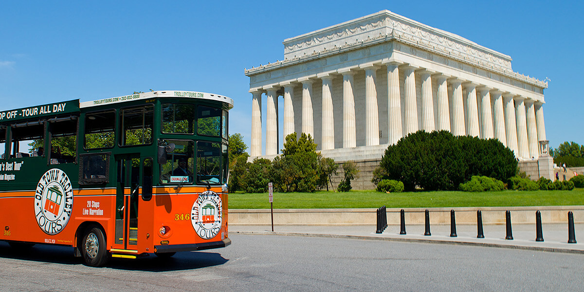 Old Town Trolley Tour driving past Lincoln Memorial