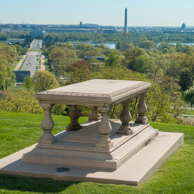 Picture of Pierre Charles L'Enfant Gravesite above ground sitting on a hill with a view of Washington DC including the Washington Monument in the background