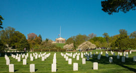 View of Arlington House made up columns in the background and tomb stones in foreground