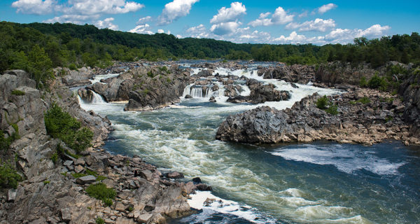 Great Falls Park featuring a river, falls and mountains