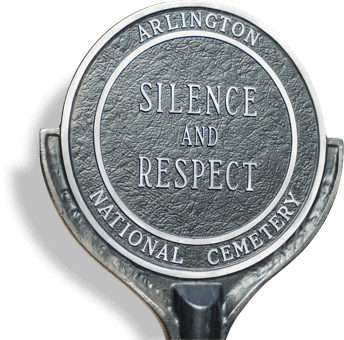 silhouette of a marker that reads 'Arlington National Cemetery Silence and Respect'